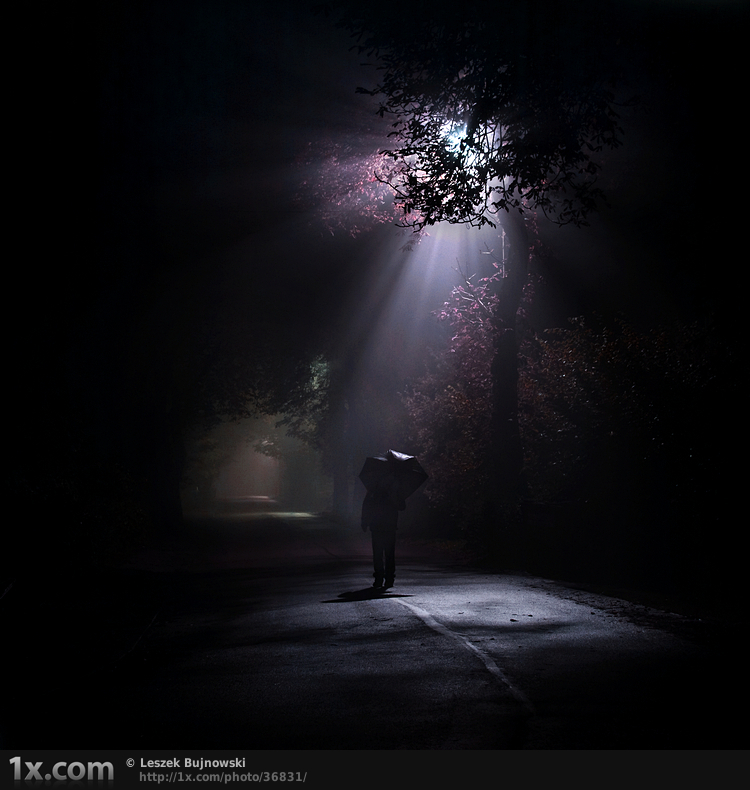 man with an umbrella walking