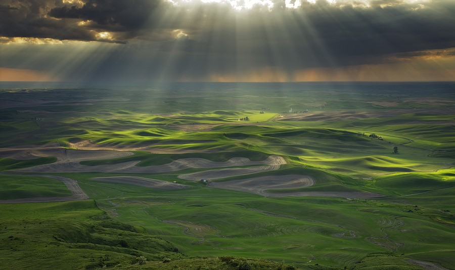 light rays illuminating land