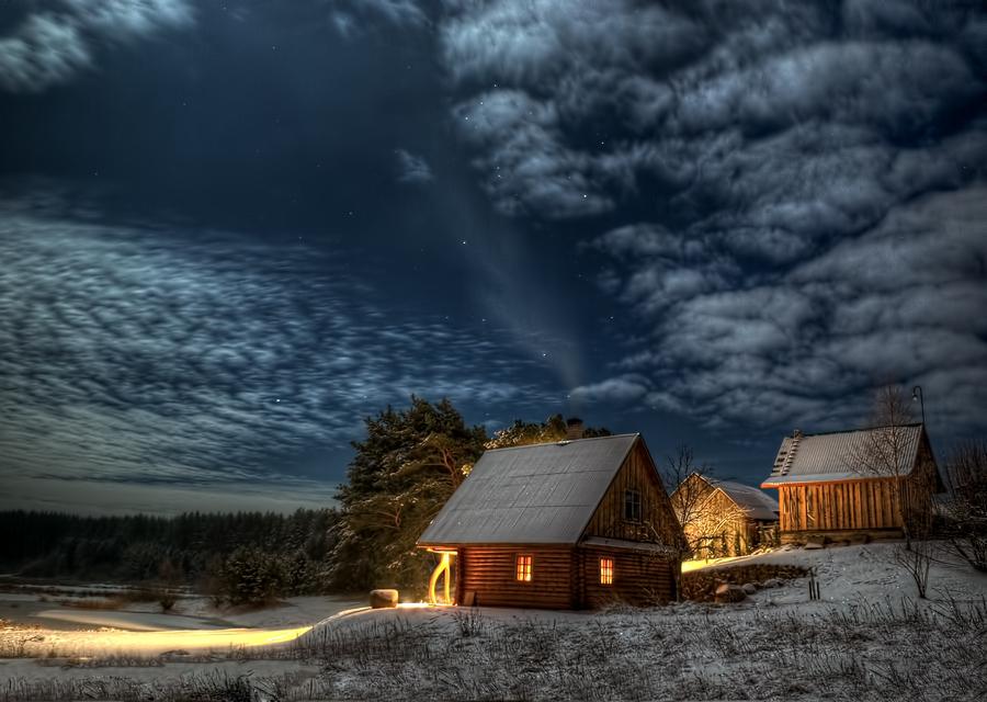 Night sky over a two shacks