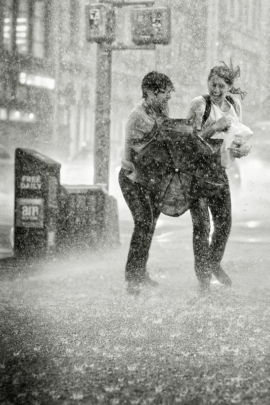 couple laughing in rain