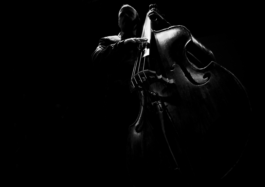 Unusual angle of man playing cello