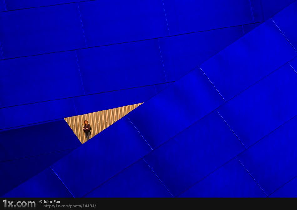 A women near a triangle window