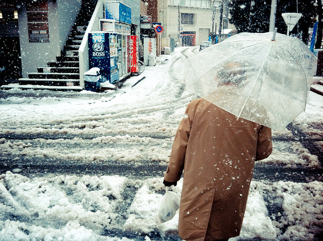 Old man with umbrella under snow -- instagram photography