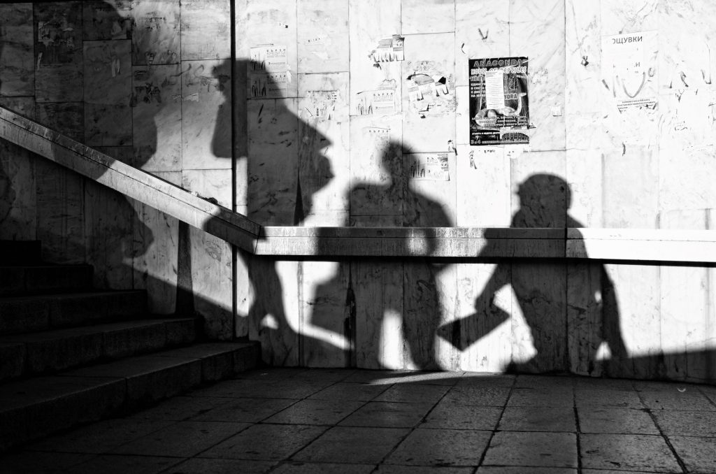 a street photograph with shadows of people -- street photography tips